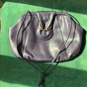 Purple leather vintage shoulder bag.